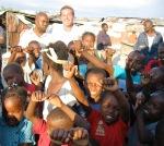 Cite Soleil, Fr Rick & man & kids