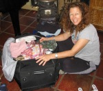 Lisa packing suitcase