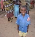 village, boy poses